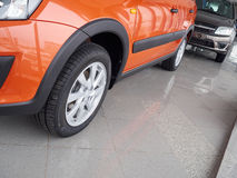 Car headlight and hood of powerful car  orange Stock Image