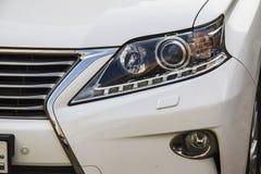 Car headlight, new Lexus GS 250. Closeup of car headlight, silver Lexus GS 250 Stock Photos