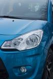 Car headlight on passenger blue car Royalty Free Stock Photo