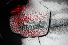 Car headlight in the snow in winter stock photos