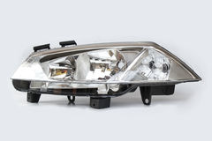 Car headlight lamp. Automotive headlight isolated on a white background Royalty Free Stock Photo