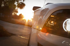 Car headlight sunset. Car headlight during sunset with palm trees in background Stock Photography