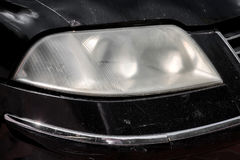 Car headlight unpolished. Headlight car unpolished misted over from within Stock Photo