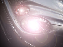 Car headlights. Close up of car with headlights on stock photos