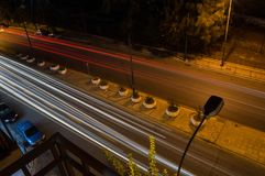 Car Headlights Forming Lines in Long Exposure Shot at Night in A. Thens, Greece stock photography