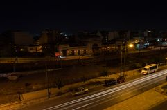 Car Headlights Forming Lines in Long Exposure Shot at Night in A. Thens, Greece stock images