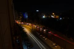 Car Headlights Forming Lines in Long Exposure Shot at Night in A. Thens, Greece stock photos