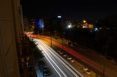 Car Headlights Forming Lines in Long Exposure Shot at Night in A. Thens, Greece stock photo
