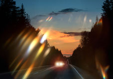 Car headlights glare on windscreen Royalty Free Stock Images