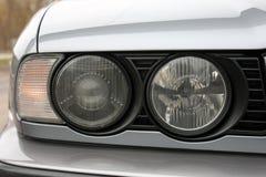 Car headlights. Luxury Headlights. Gray car stock image