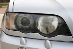 Car headlights. Luxury Headlights. Gray car royalty free stock photo