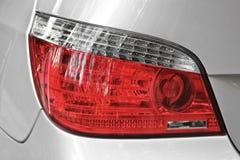 Car headlights. Luxury Headlights. Gray royalty free stock images