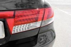 Car headlights. Luxury Headlights. Black stock images