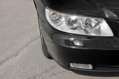 Car headlights. Luxury Headlights. Black royalty free stock image
