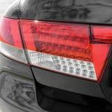 Car headlights. Luxury Headlights. Black stock photos