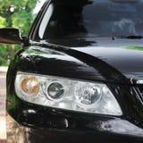 Car headlights. Luxury Headlights. Black royalty free stock photography