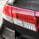 Car headlights. Luxury Headlights. Black stock image