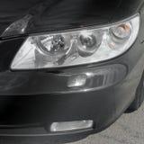 Car headlights. Luxury Headlights. Black stock photography