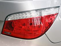 Car headlights. Luxury Headlights. Gray stock image