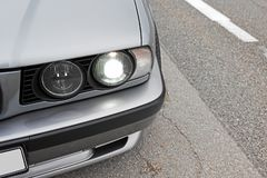 Car headlights. Luxury Headlights. Gray car stock photo