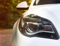 Car headlights. Luxury Headlights. White stock photography
