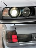 Car headlights. Luxury Headlights. Gray car royalty free stock photography