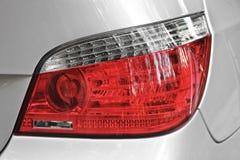 Car headlights. Luxury Headlights. Gray royalty free stock image