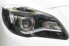 Car headlights. Luxury Headlights. White royalty free stock photos