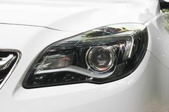 Car headlights. Luxury Headlights. White stock images
