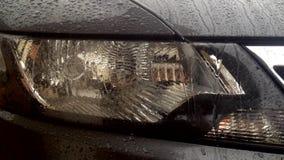 Car Headlights at rainy day with rain sound stock footage
