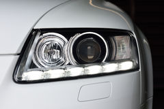 Car headlights. Headlights of a car showing daytime running lights Stock Photo