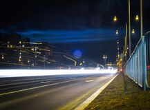 Car headlights on street at night Royalty Free Stock Image