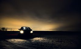 Car headlights turned in night field Royalty Free Stock Photography