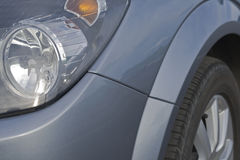 Car headlights and tyre in a close up. Angle royalty free stock photography