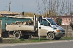 Transportation of heavy load. Car with heavy load of dump stock photography