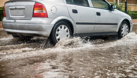 Car during heavy rain. Royalty Free Stock Photo