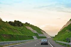 Car on a Highway Stock Photos