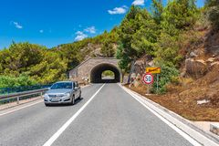 Car highway along the coast of the Adriatic Sea, in Omish, Croatia. Omish, Croatia - July 3, 2017: Car highway along the coast of the Adriatic Sea, in Omish stock image