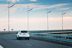 Car on highway curve Stock Photo