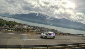 Car on the highway, mountains and lakes Stock Photo