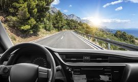 Car on the highway. Car rushes along the highway. View from the first-person of the driver royalty free stock photo