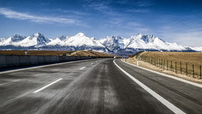 Car on highway and Tatra mountains, Slovakia Stock Images