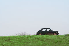 Car on hill royalty free stock photography