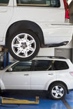 Car on hoist in automobile repair shop Stock Photo