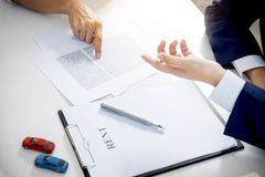 Car and Home for rent concept, broker agent presenting and consult to customer to decision making sign form agreement, home and c stock photography