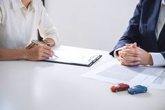 Car and Home for rent concept, broker agent presenting and consult to customer to decision making sign form agreement, home and c royalty free stock image