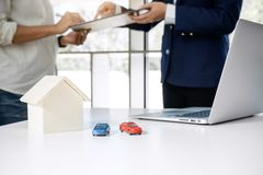 Car and Home for rent concept, broker agent presenting and consult to customer to decision making sign form agreement, home and c royalty free stock images