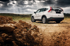 Car Honda CR-V stand at countryside road near forest at daytime Royalty Free Stock Photography