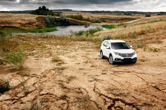 Car Honda CR-V stand at countryside road near forest at daytime Royalty Free Stock Photo