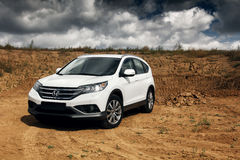 Car Honda CR-V stand at countryside road near forest at daytime Stock Photos